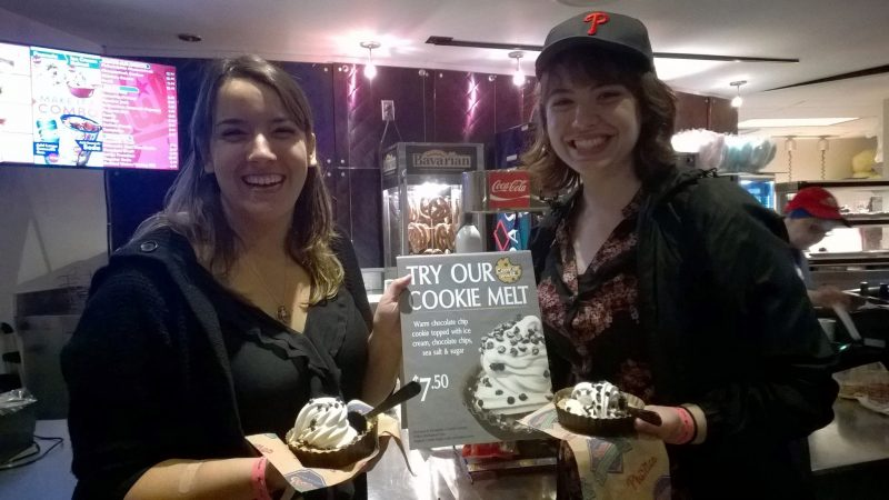Photograph of Megan Larkin '17 and Stephanie Cressler '16 at the Cookie Melt launch their ice cream creations
