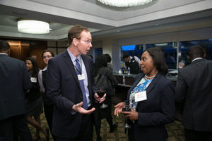 Dean Mark Nelson, left, talks with JMB 2016 attendees during a reception