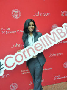 Chandni Prasad, Two-Year MBA '19 with #CornellMBA sign