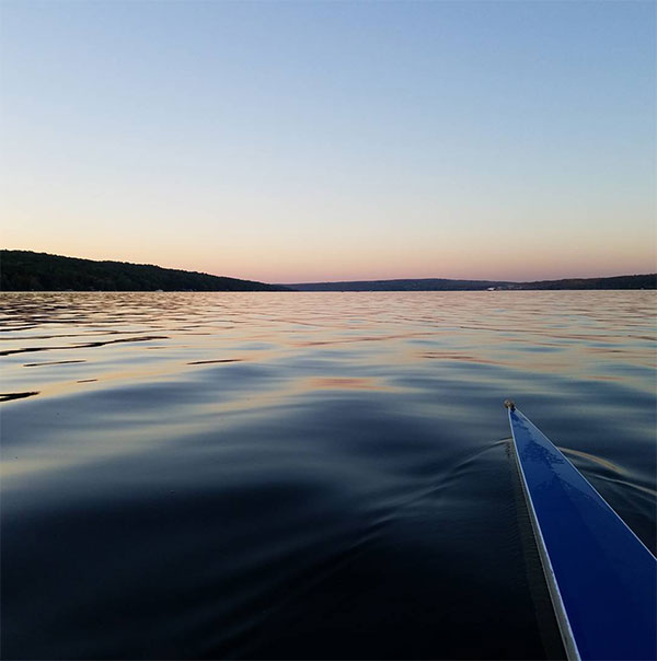 Rowing at Cayuga lake in the sunset