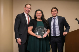 Photo of Dean Mark Nelson and Andrés Quintanilla, MBA '18, present Adrienne Martinez '01, MBA '08 (center), with the Carlos R. Quintanilla Distinguished Latino/Latina Alumni Award