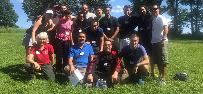 Photo of Team Mississauga and Team Lima-Santiago at Cornell's Hoffman Challenge Course