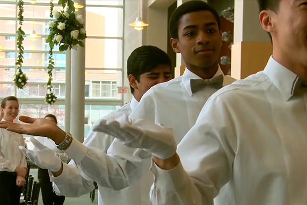 Photo of students volunteering at Hotel Ezra Cornell