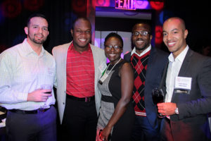 Photo of Jorge Garcia, MBA '16, at the 2015 Office of Diversity and Inclusion Reception in New York City (far right)