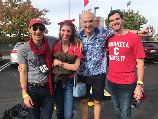 Photo of the assembled team at Cornell's 2017 Homecoming Weekend football game and tailgate (From left: Harrison Jobe, Caroline Wright, Michael Brady, Chris Alberico)