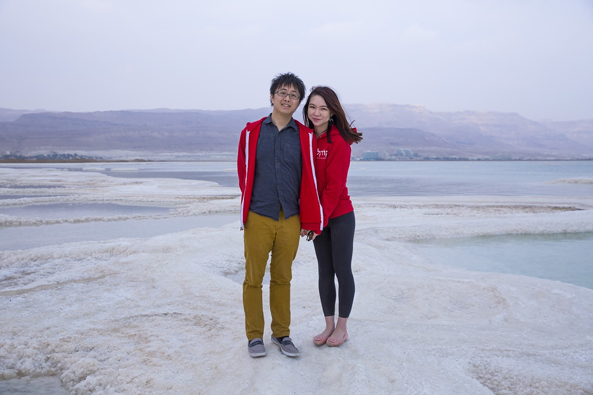 Photo of Izumni and Yifan on a salt formation in the Israeli Dead Sea