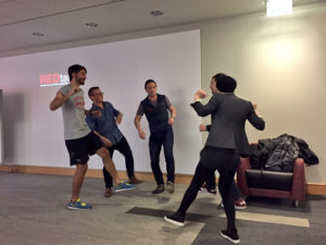 Photo of Jim and his classmates doing an improv exercise