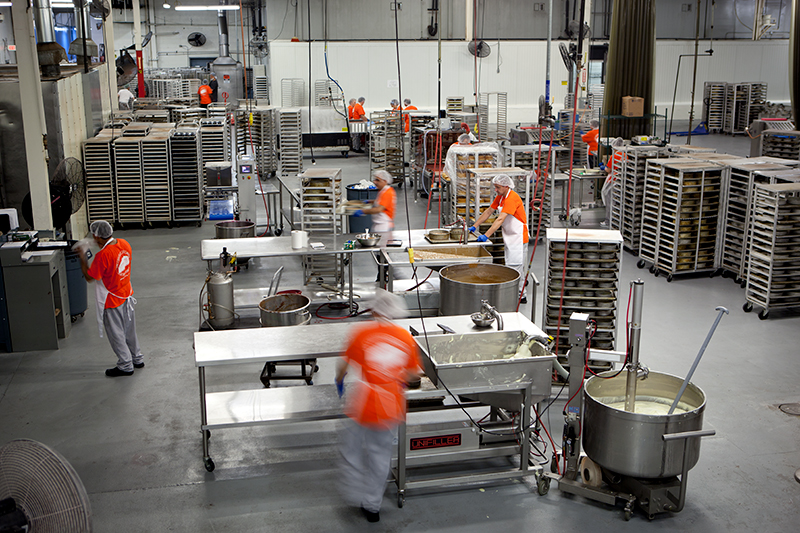 Photo of several people working in an industrial kitchen