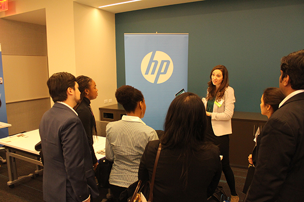 Photo of a women from HP talking to students