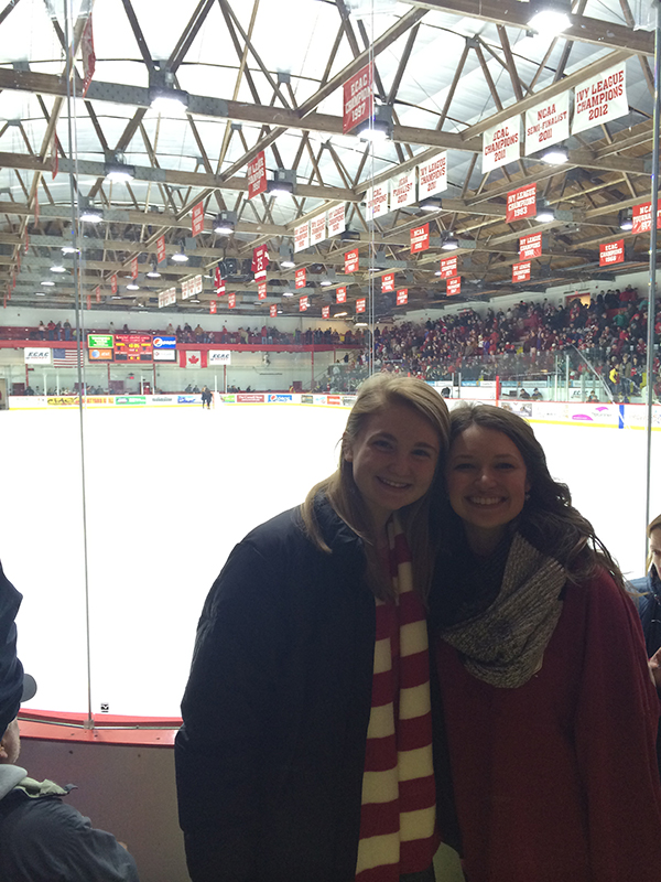 Photo of two students in front of the ice at the Cornell's Lynah Rink