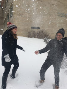 Photo of Kayti and Ryan laughing in the snow