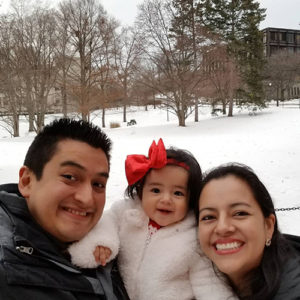 Photo of Carlos, Abby, and Cynthia in the snow on campus