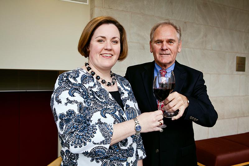 Photo of Stanley and Mutkoski toasting wine