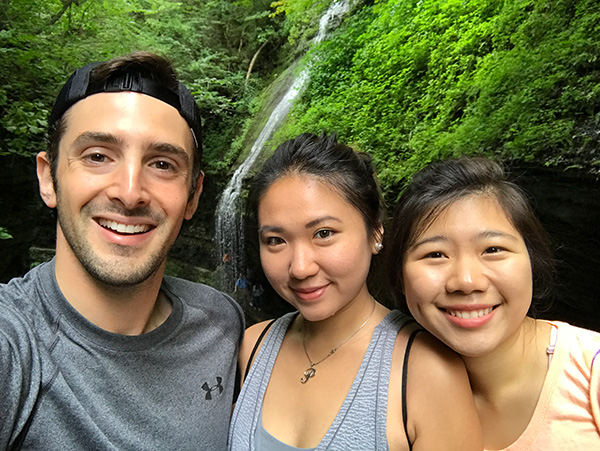 Photo of Nathan with two other students in front of one of Ithaca's gorges