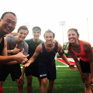 Photo of Nathan and his friends at Cornell's running track