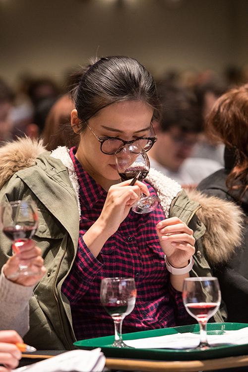 Photo of a student tasting red wine