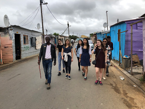 Photo of students walking through the village