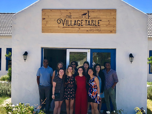 Photo of the group at the entrance to the restaurant