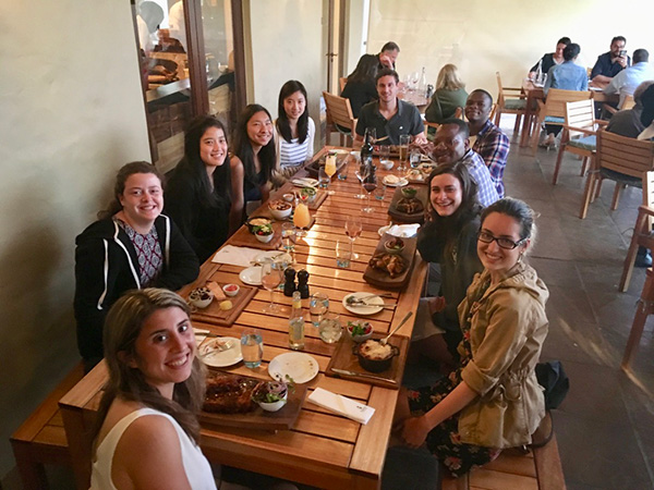 Photo of students sitting around a table