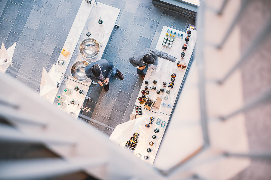 Photo of two men working at a food table from above