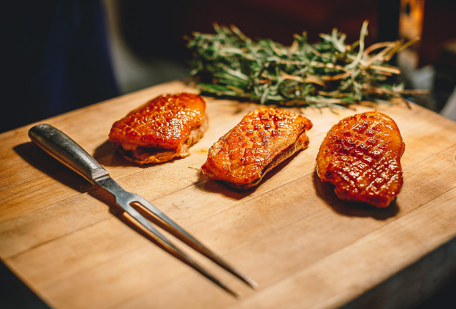 Photo of steaks on a cutting board