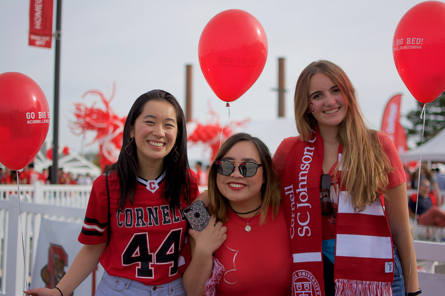 Photo of Eri and two other students wearing red for Cornell homecoming