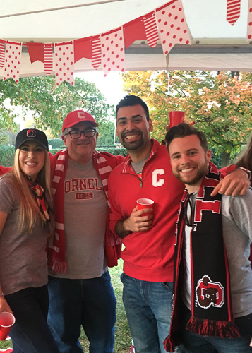 Photo of Nick and Katie with two others in Cornell gear