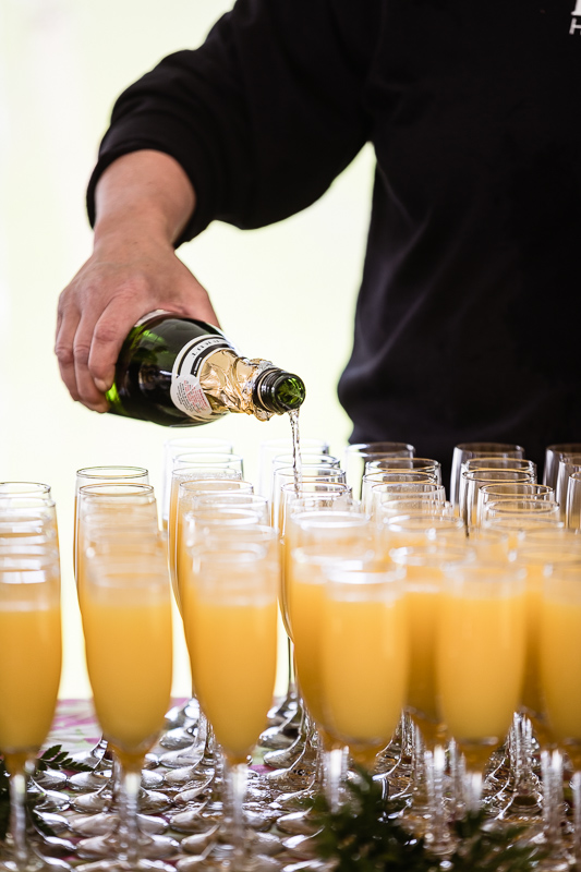 Photo of mimosas being poured