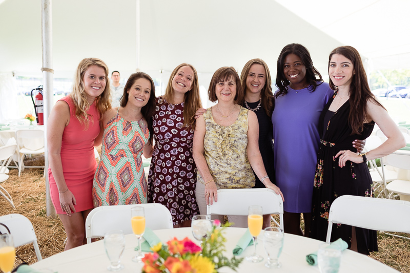 Photo of women standing behind a table