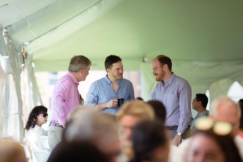 Photo of three men talking