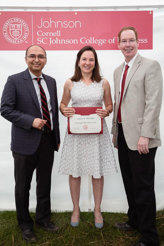 Photo of Lauren holding a certificate