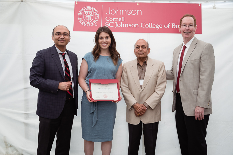 Photo of administrators and Hannah holding a certificate