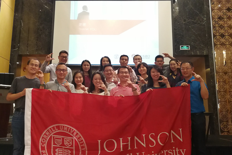 Photo of a group of people holding a Johnson banner