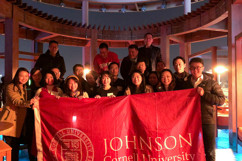 Photo of a group of people holding the Johnson banner