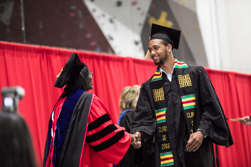 Photo of graduate walking across the stage