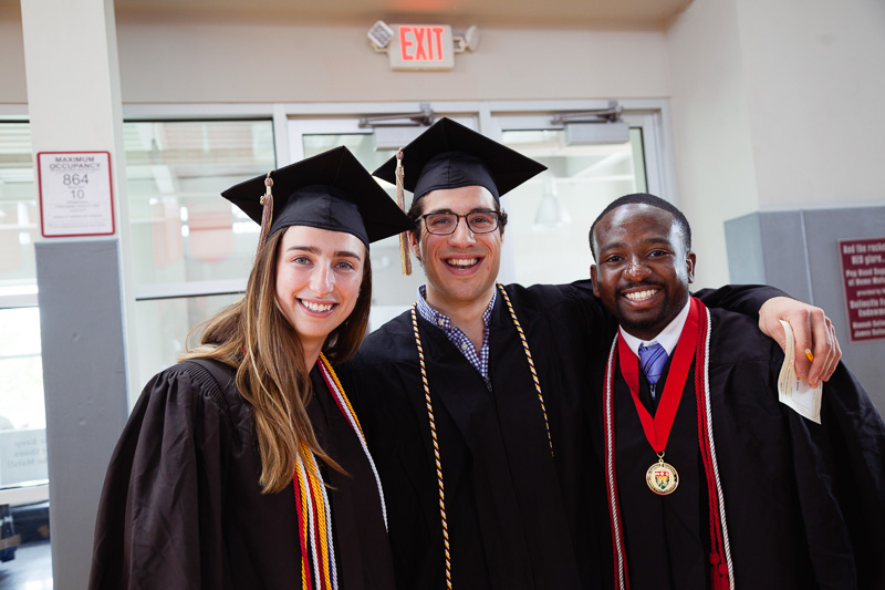 Photo of three graduates in their gowns