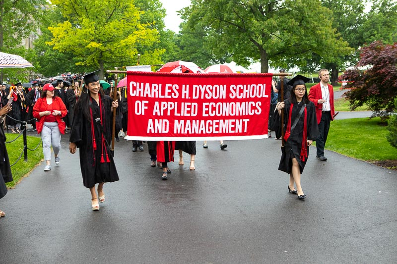 Photo of graduates carrying the Dyson banner