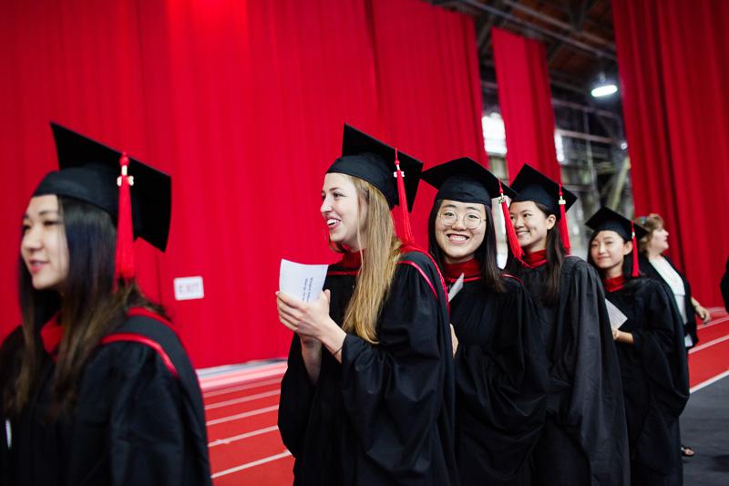 Photo of graduates walking to get their degrees