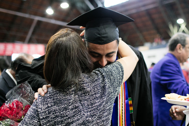 Photo of a graduate hugging a woman
