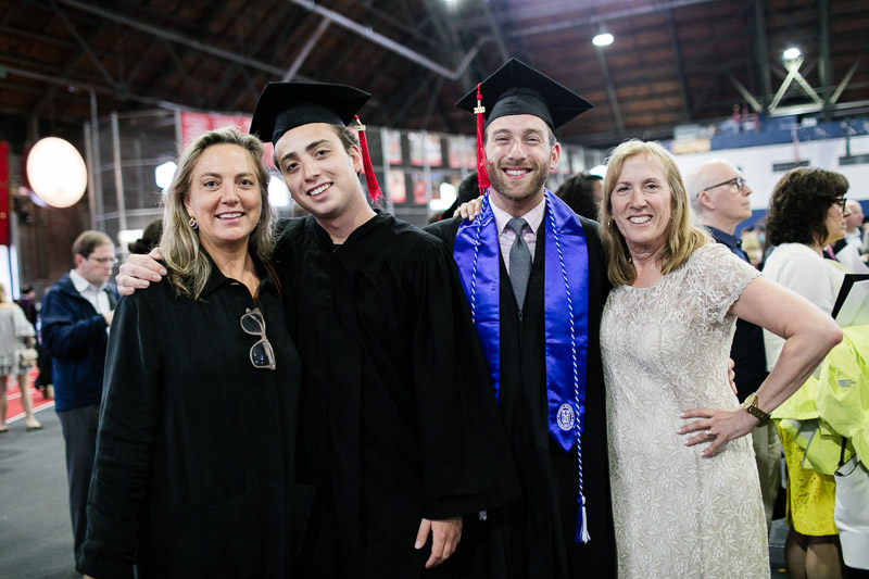 Photo of two graduates and their mothers