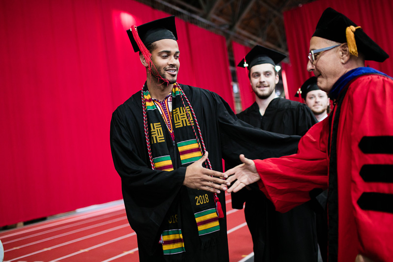 Photo of a graduate shaking someone's hand