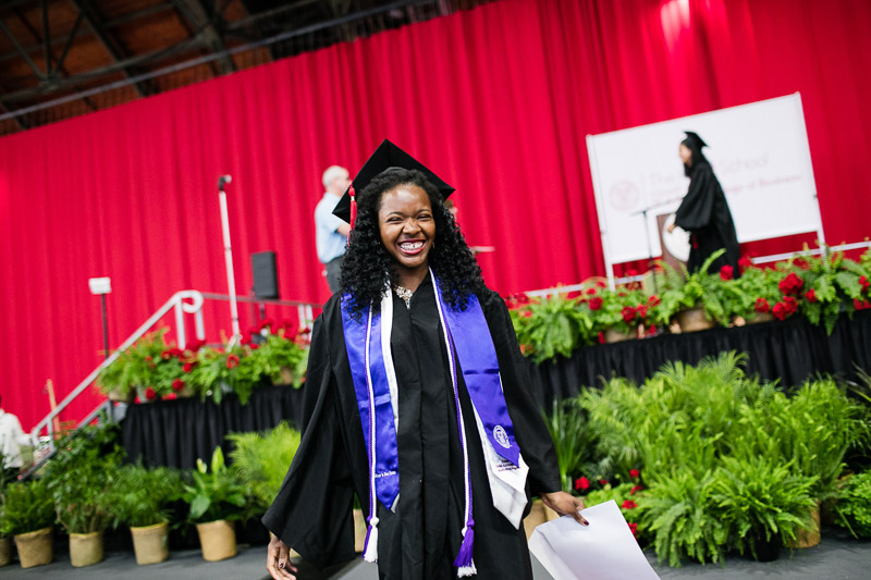 Photo of a smiling graduate
