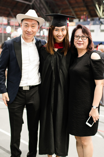 Photo of a graduate and her parents
