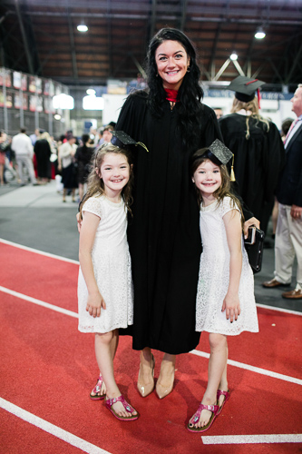 Photo of a graduate with two young girls