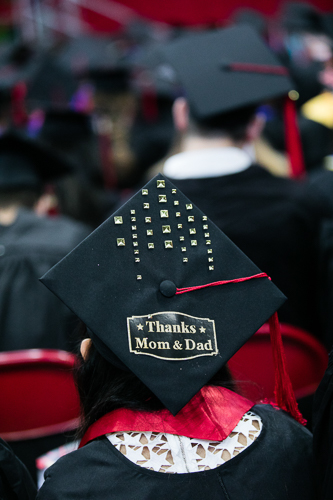 """Photo of a cap that says """"thanks mom & dad"""""""