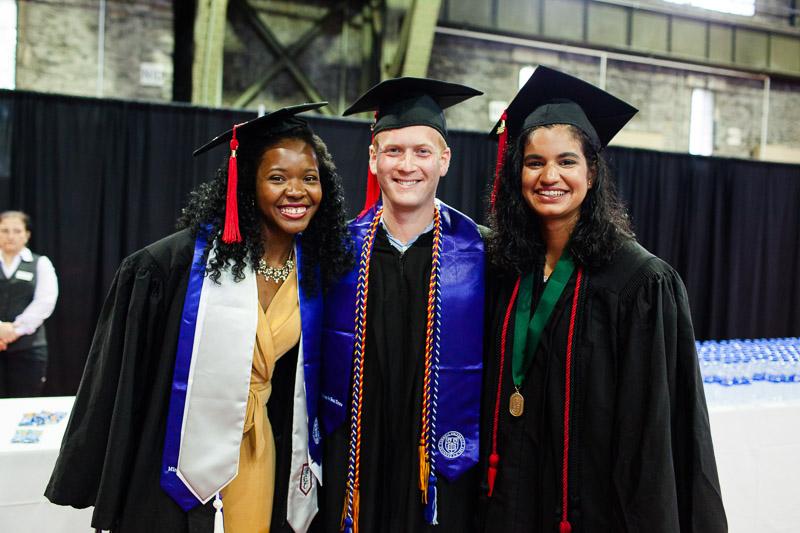 Photo of three graduates