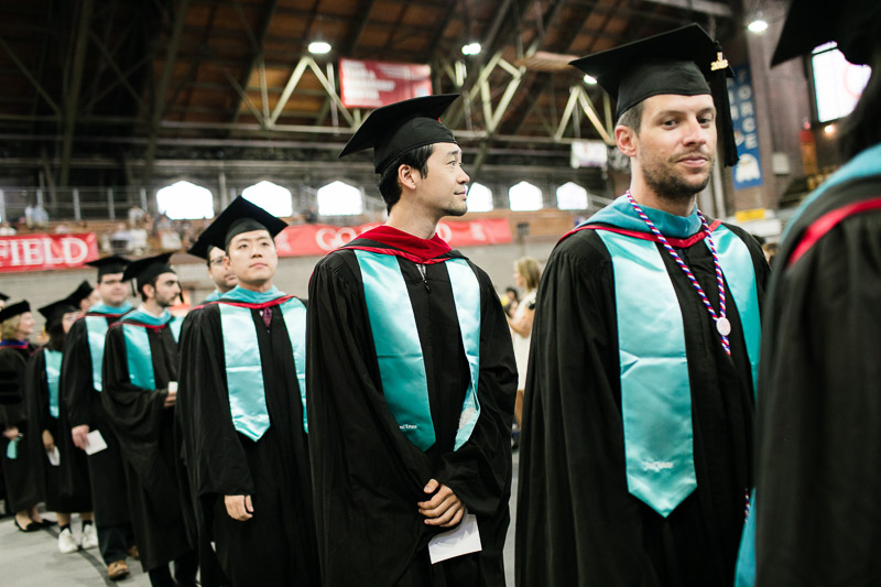 Photo of graduates walking into the ceremony