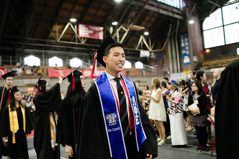Photo of a graduate walking in