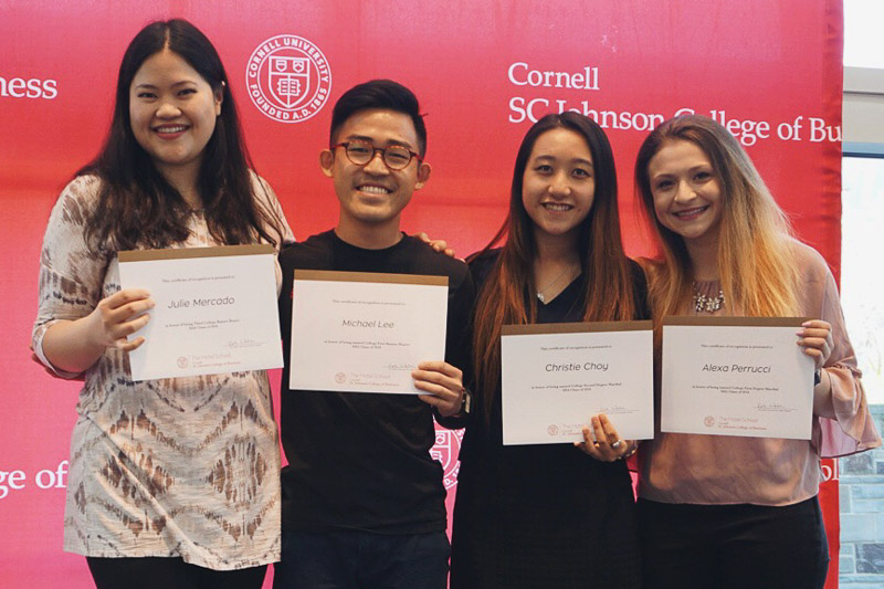 Photo of Julie, Michael, Christie, and Alexa standing with certificates
