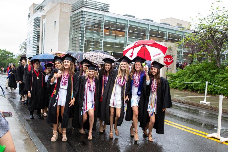 Photo of female graduates walking to the stadium